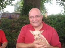 Jeff with Adam's parent's dog, Minnie . . . or is it Mini?