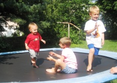 Joseph, Anna, and Luke Myers on their trampoline in the back yard in Lee's Summit.