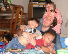 Blayne Riffle with Beth's three kids (oldest-youngest) Anna, Luke, and Joseph. Blayne still had the upper hand.