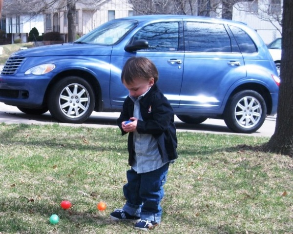 Joseph Myers grabs an egg. My rental PT Cruiser is in the background.