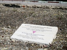 A plaque inside the walls of a barracks commemorating the homosexuals who died at Buchenwald.