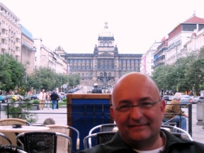 Prague. 2008. JC at the Tramvaj Cafe on Wenceslas Square, with the National Museum in the background.