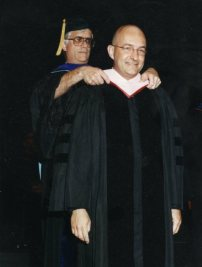 2000. Paul Laird 'hoods' me for my doctorate at (insert fanfare here) the University of Kansas.