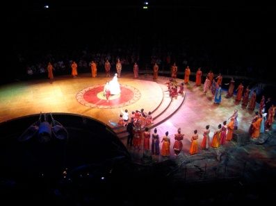 The King and Anna bow at the Royal Albert Hall.