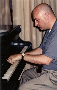 Playing Carlos Gomes' piano at the Gomes museum in Campinas.