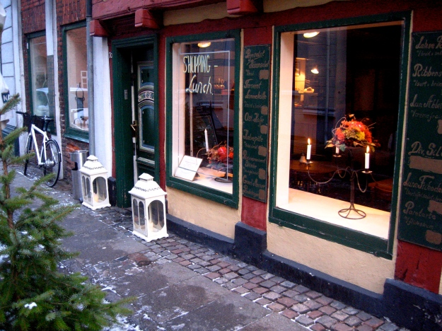 The front window of the restaurant.  Look at the candles in the lanterns beside the door.