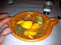 My pre-dinner cocktail, served in a clay bowl.