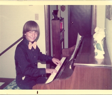 1975. At the piano, in the home on Wingate.