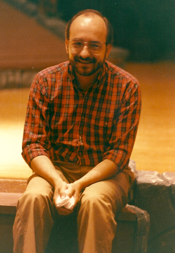 I was music director for Brigadoon at Blue Springs City Theatre.  Someone took this photo of me, sitting on the edge of the stage. I had a cold -- that I remember well!