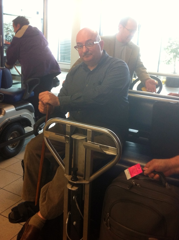 On a cart at Schiphol.  I ended up walking the short distance to Immigration after all.