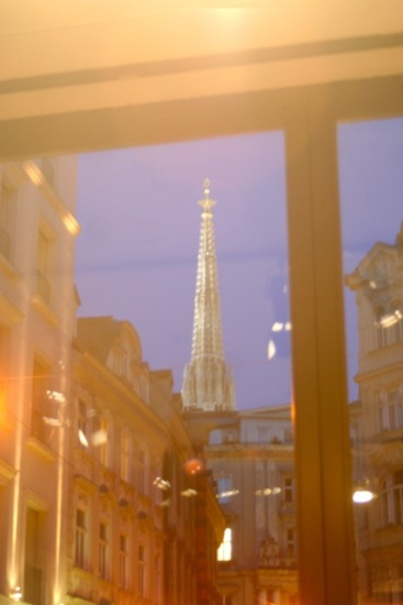 The spire of Stephensdom from a shop.