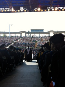 Norbert Leo Butz delivering his Commencement address at the Muny.