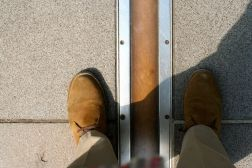 Astride the Prime Meridian, one foot in the Western Hemisphere, the other not.