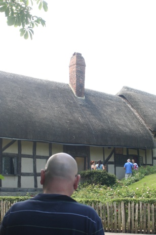 Kevin observes Anne Hathaway's cottage.