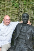 With Sir Edward, sort of, in his garden.
