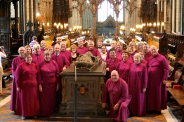 My choir colleagues and I surrounding the tomb of King John.
