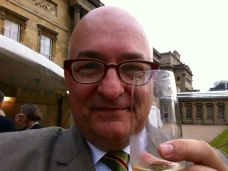 Enjoying a glass of bubbly in the Queen's back yard.