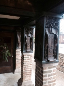 Capitals on the porch outside his studio.