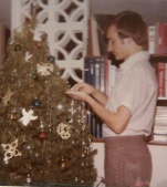In my dorm room, decorating a Christmas tree during my freshman year at SBU.