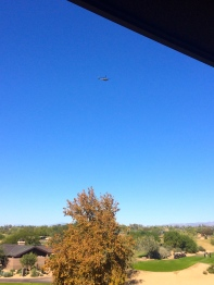 Military helicopter flies over the resort.