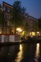 Streetlights on water, 5 a.m.