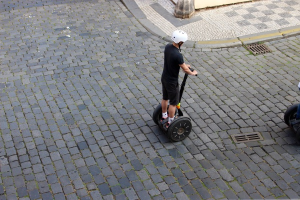 Segways are everywhere. A nuisance. At least this kid on our street had a helmet on.
