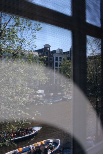 Through a front window, across the canal.