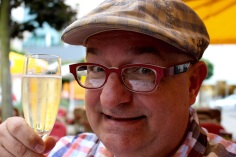 Midday. Happy guy with Cava.