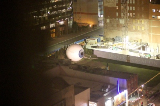 I'm not certain why a big eyeball is a couple of blocks away.