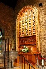 Organ screen and baptistry.