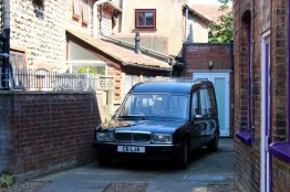 Hearse by a funeral home on our walk into town.