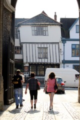 Leaning half-timbered building.