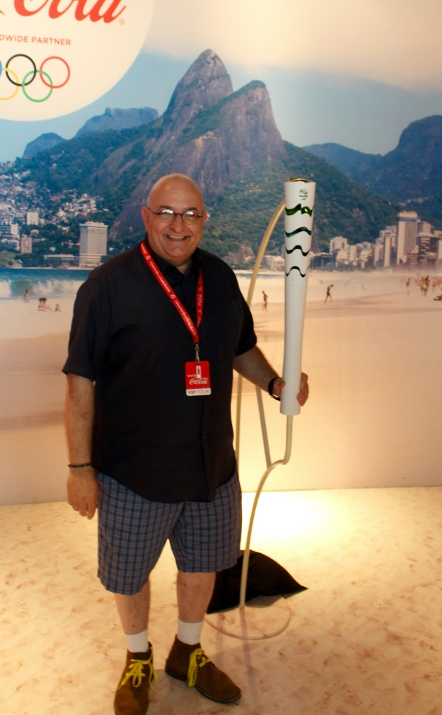 With a Rio 2016 Olympic torch, at the Coke extravaganza.