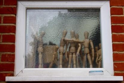 In a window as I walked along.