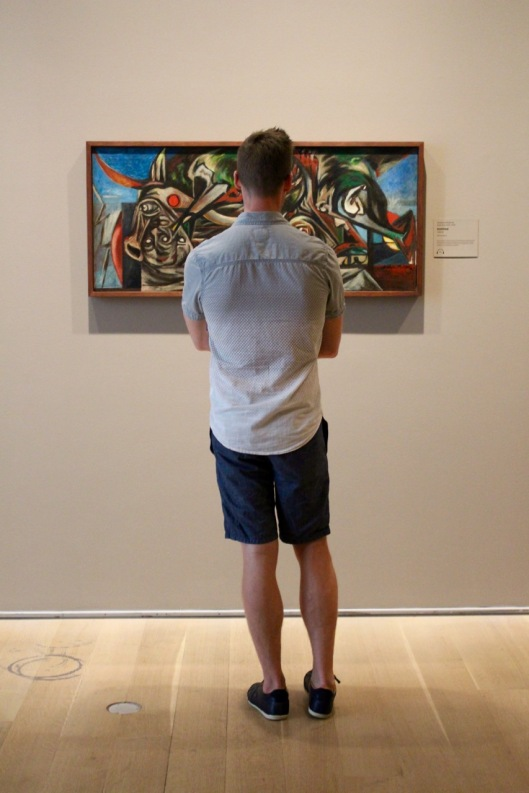 I loved the symmetry of the view: a visitor and the painting he observes.