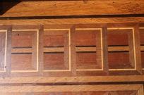 Inlaid wood floor in smoking room.