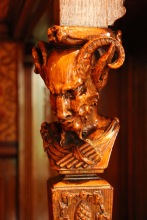 Carved wood faun in sewing room.