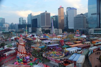 A carnival, viewed from the carousel.