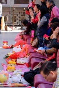 Praying . . . over food.