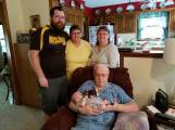 Pop with baby Lily. Standing: Blayne, the father; Karen, the grandmother (which still seems odd to say); Beth, the great-aunt.