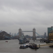 HMS Belfast and Tower Bridge, on a gray day.