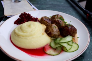 My Tuesday lunch of Swedish meatballs, whipped potatoes, pickled cucumber, and tart lingonberries.