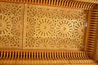 The retractable roof has exquisitely carved wood.