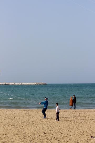 Flying kites on the beach.