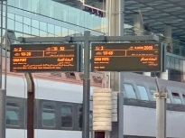 Railway signs are in Arabic and French.