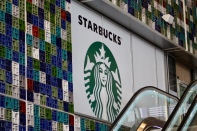 Starbucks is opening in the Casablanca train station. Achraf doesn't think it will be successful.