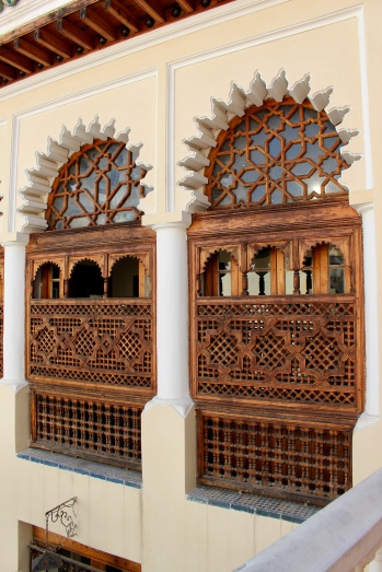 Wooden grills over the courtyard windows.