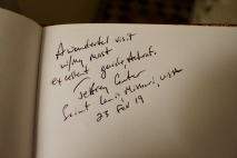 Signing the guestbook.