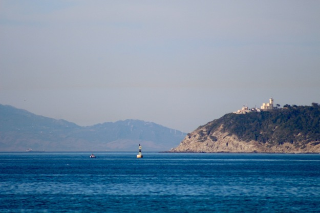 The coast of España in the background.